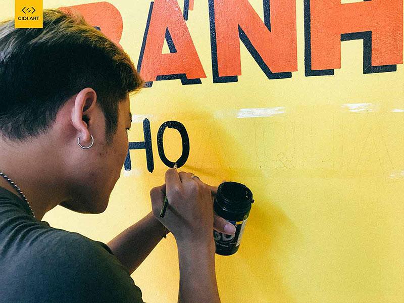 Báo giá vẽ tranh tường logo cửa hàng